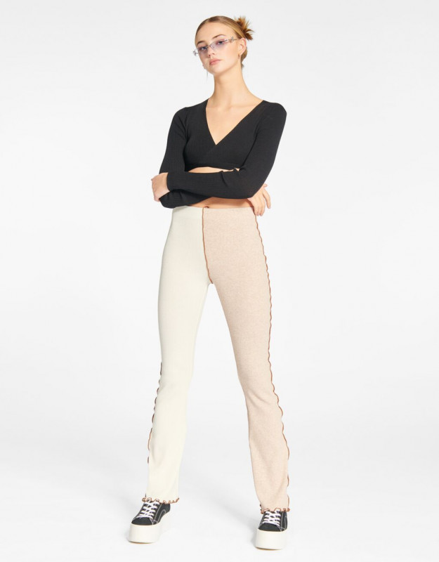 Flared trousers with contrasting detail